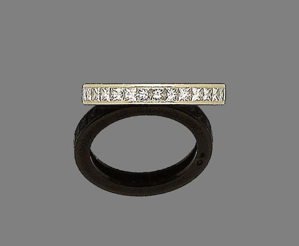A gold and diamond eternity ring, by Cartier