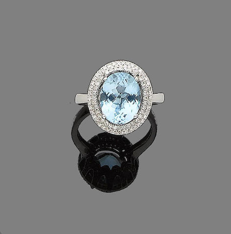 A blue topaz and diamond ring