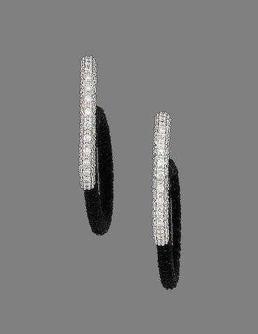 A pair of diamond earhoops, by David Morris,