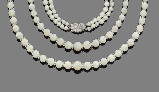An early 20th century two-strand opal, rock crystal and diamond necklace