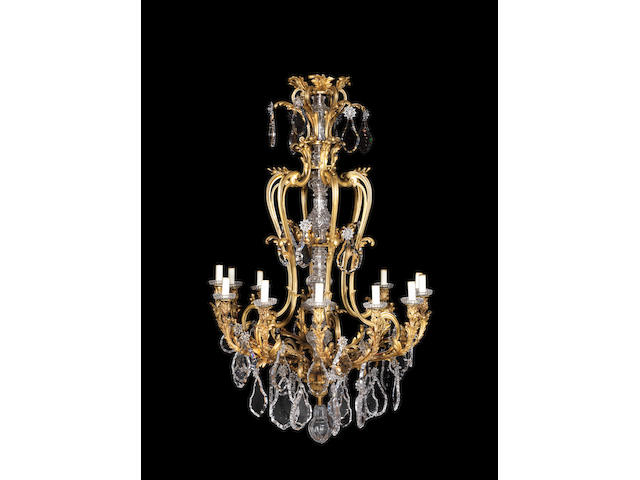 An impressive French late 19th century Louis XV style gilt-bronze and cut-glass twelve-light chandelier