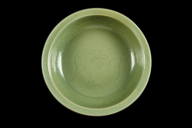 A finely potted celadon 'twin fish' dish Ming dynasty