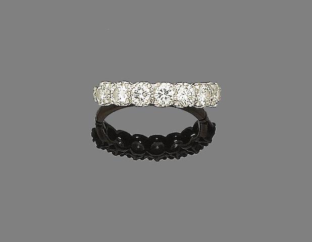 A diamond half-hoop ring,