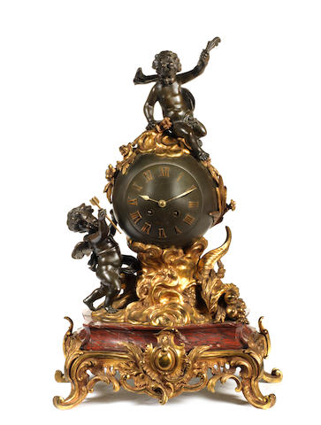 A French late 19th century Griotte marble, gilt and patinated bronze mantel clock