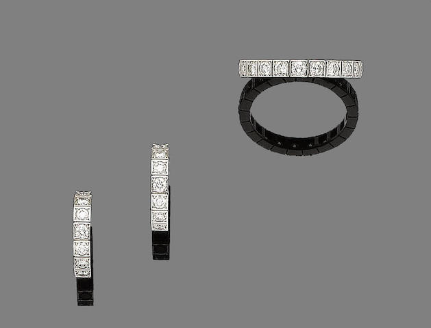 A diamond 'Lanières' eternity ring and earhoop suite, by Cartier (2)