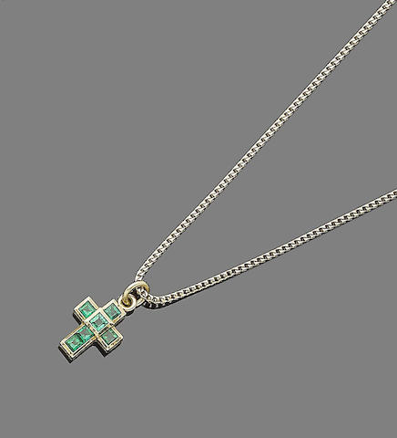 An emerald cross pendant, by Theo Fennell,