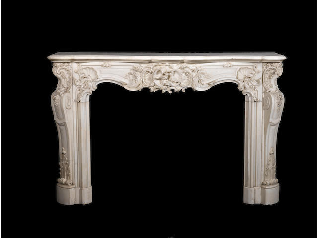 A French mid-18th century Louis XV carved white marble fireplace