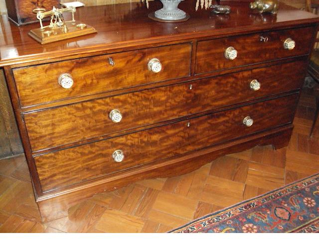 An unusual mahogany chest of two short and two long graduated drawers