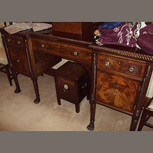 An Irish late Regency mahogany and crossbanded reverse breakfront sideboard