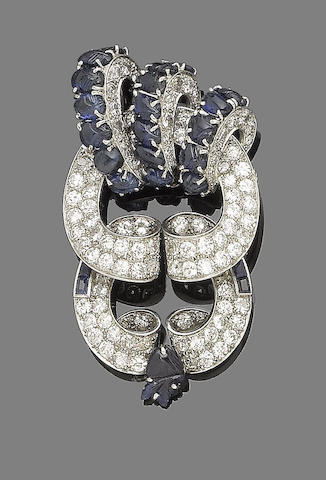 A sapphire and diamond brooch/pendant,