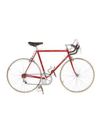 "Norman Hill, Chassis No. 012, hand built 1980 in red, 22"" frame, Campagnolo chain set, ten gears, Nisi rims, Unicanitar seat (manufactured in Canada)"