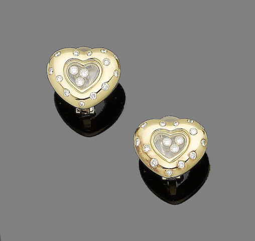 "A pair of ""Happy Diamond"" earclips, by Chopard"