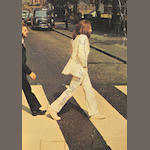 A copy of the Beatles' album 'Abbey Road' autographed by John Lennon,