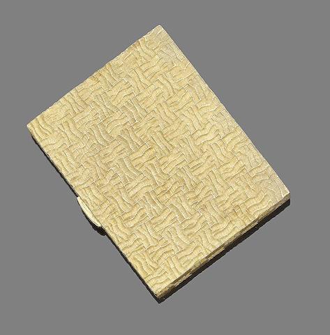 A gold compact, by Garrard & Co,