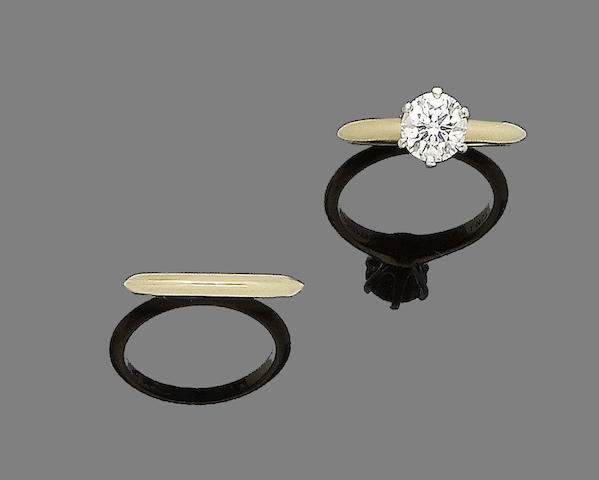 A diamond single-stone ring and a band ring, by Tiffany & Co., (2)