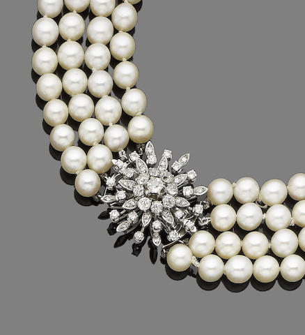 A four-row cultured pearl and diamond necklace