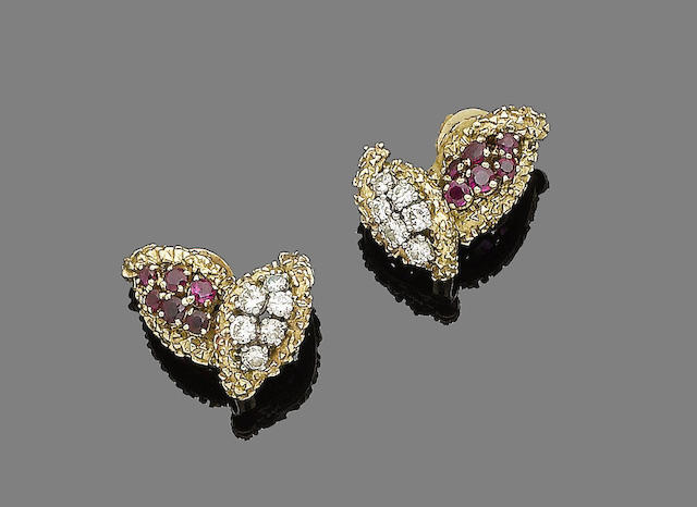 A pair of ruby and diamond earclips, by Boucheron