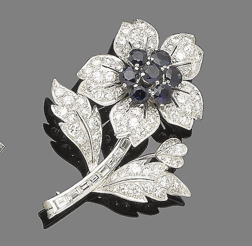 A sapphire and diamond flower brooch