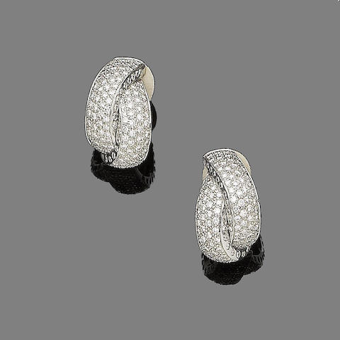 A pair of diamond earclips, by Wempe