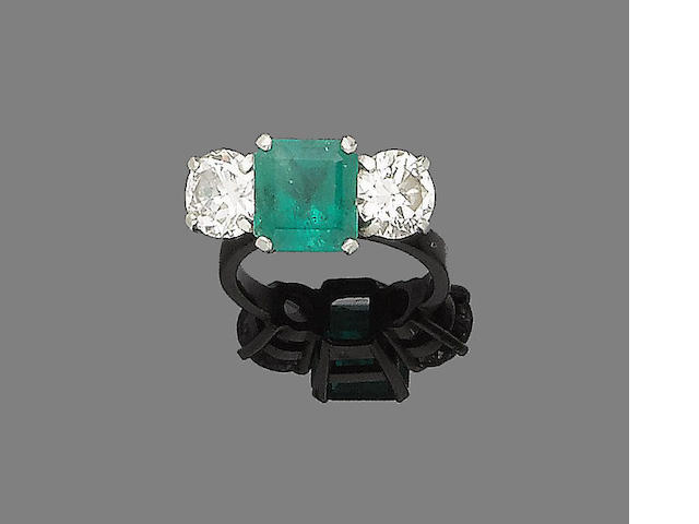 An emerald and diamond three-stone ring,