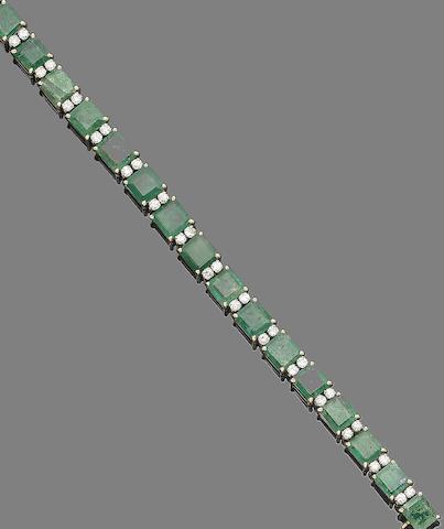 An emerald and diamond line bracelet