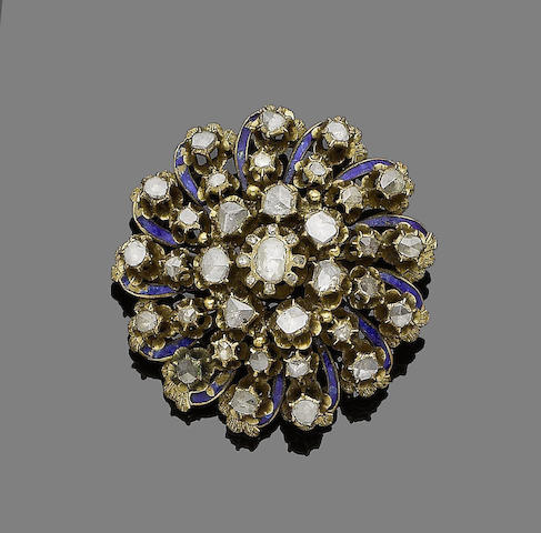 A late 19th century/early 20th century enamel and diamond brooch/pendant