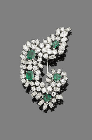 An emerald and diamond spray brooch