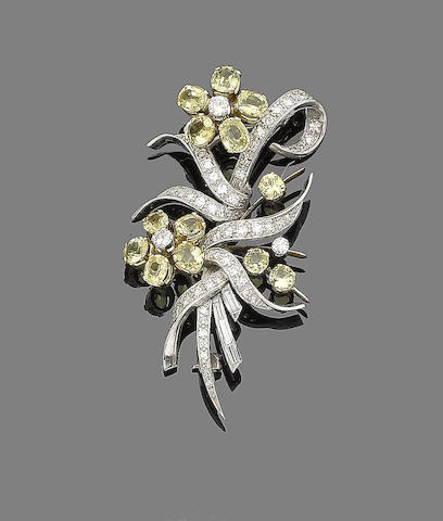 A yellow sapphire and diamond flower brooch