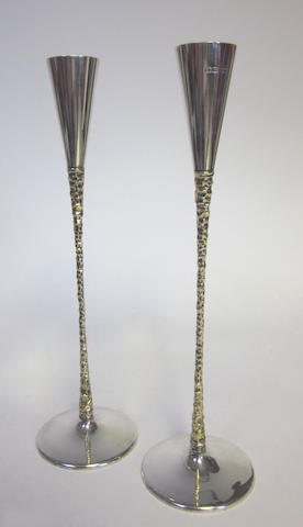 STUART DEVLIN: A pair of silver and silver-gilt tapersticks London 1972  (3)