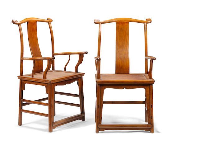 A good pair of Chinese hardwood 'yoke-back' armchairs, in the 17th century manner Late 19th/early 20th century