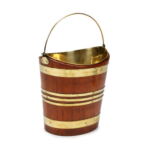 A Regency mahogany and brass-bound navette-shaped bucket