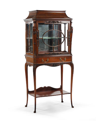 A carved mahogany and glazed display cabinet, circa 1900