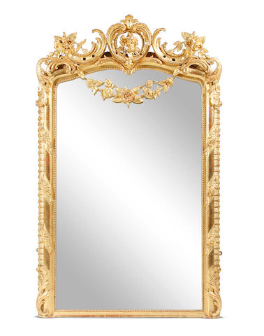 A large giltwood-framed wall mirror