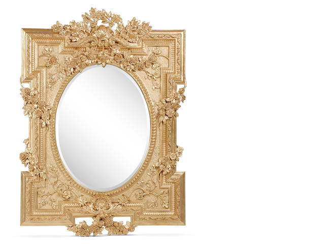 A giltwood and composition wall mirror