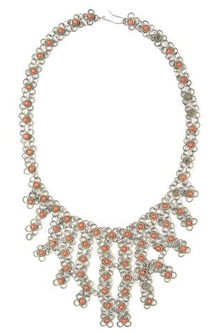 Eric Clapton / Cream: A silvered metal necklace with coral coloured inlay worn by Eric Clapton with Cream, 1967,