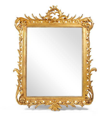 A large giltwood-framed rectangular wall mirror
