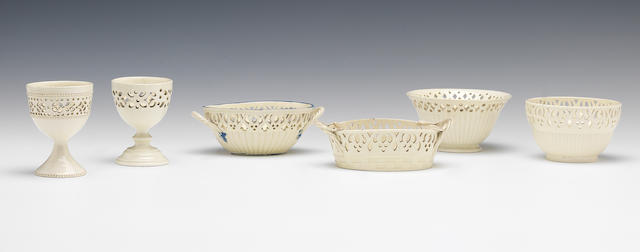 Two creamware egg cups, two miniature baskets and six custard bowls, circa 1775-85