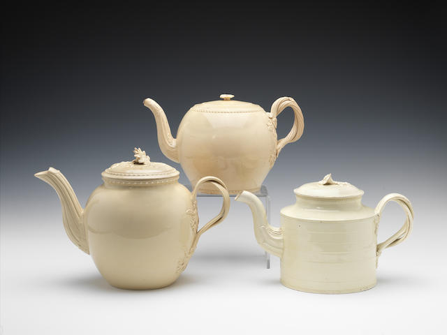 Three large creamware teapots or punch pots and covers, circa 1780-85