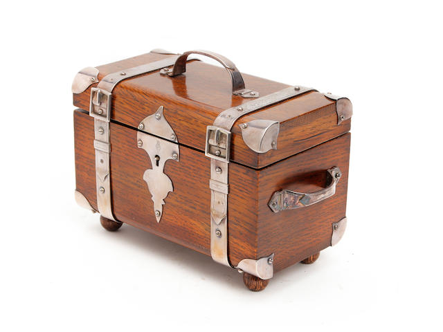 A Victorian oak tea caddy with silver-plated strap mounts, circa 1880The silver straps stamped with a registration lozenge for 28th August 1879