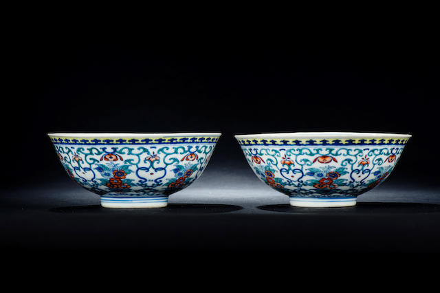 A pair of brilliantly enamelled doucai 'floral spray' bowls  Qianlong six-character seal marks and of the period