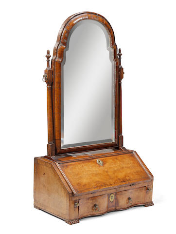 A Queen Anne-style walnut-veneered dressing mirror