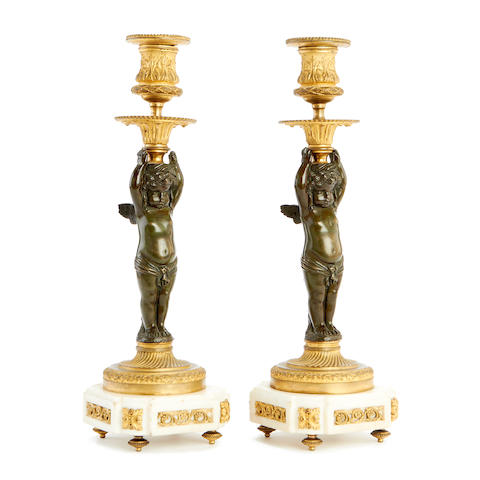 A pair of mid 19th century gilt and patinated bronze figural candlesticks