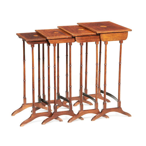 An Edwardian nest of rosewood and fruitwood inlaid quartetto tables