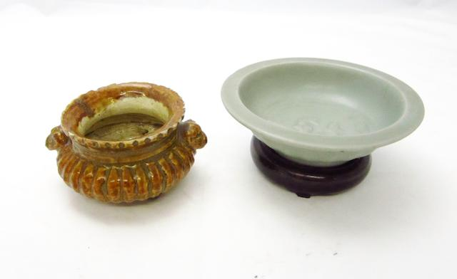 A glazed porcelain tripod censer and a celadon dish