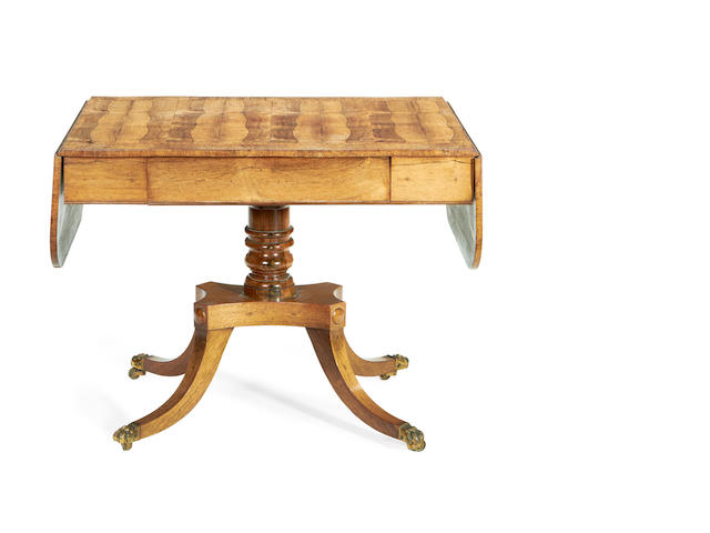 A Regency rosewood and satinwood banded sofa table