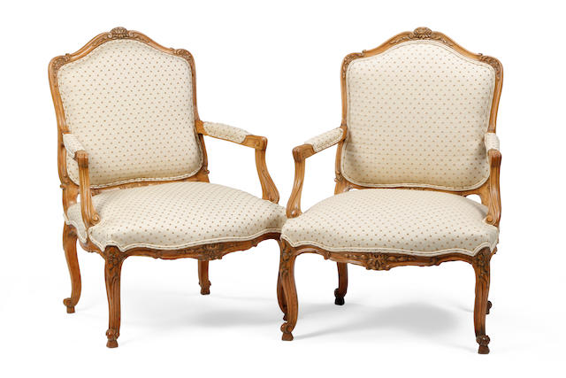 A pair of beech-framed fauteuils, in the Louis XV manner