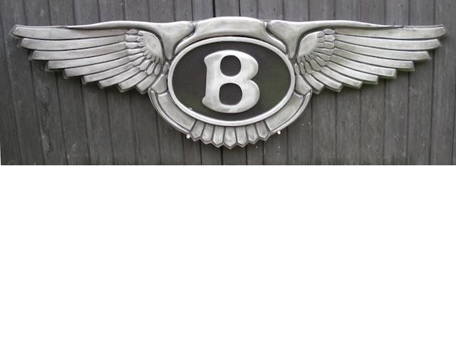A Bentley 'winged B' garage display emblem,