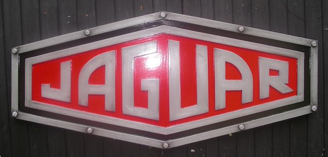 A Jaguar badge garage display emblem,