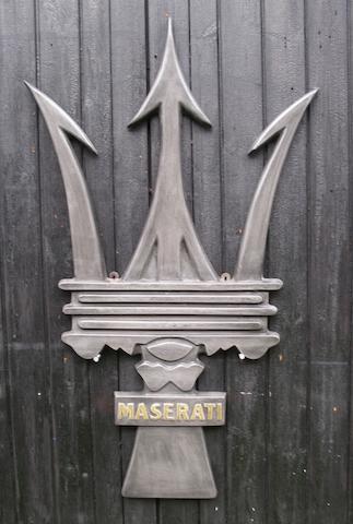 A Maserati Trident garage display emblem,