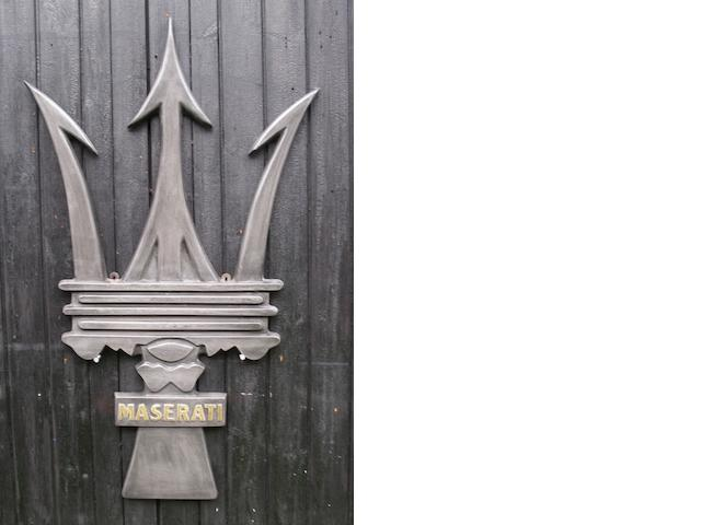A Maserati Trident garage display emblem,